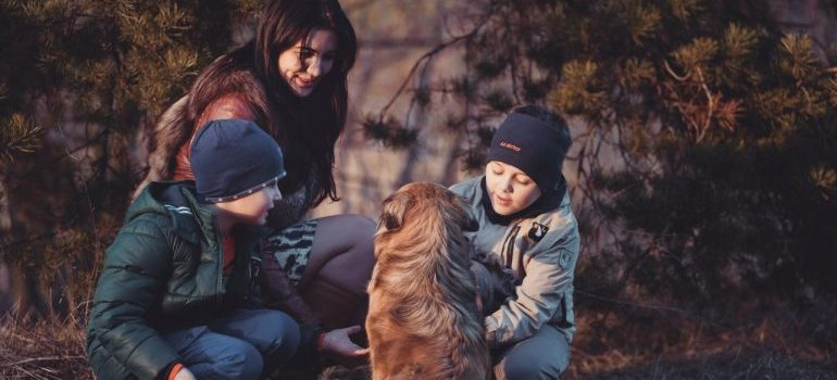 Family with their dog playing in a park
