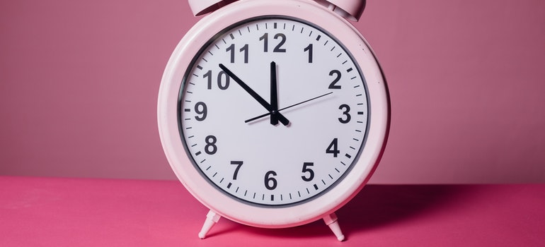 pink clock on the table