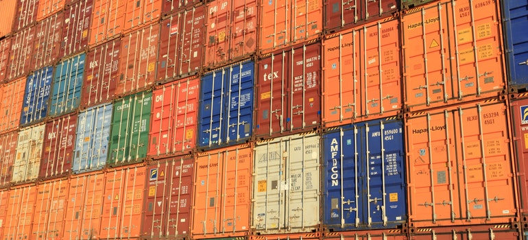 many containers stacked atop one another visualizing one of the most useful tips for packing a storage container