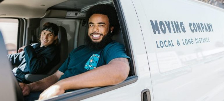two movers in a van will help you move in bad weather
