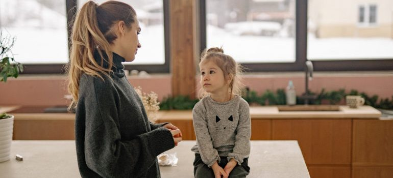 mother talking with kid why they should move during school year