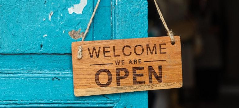 welcome sign hanging on a door