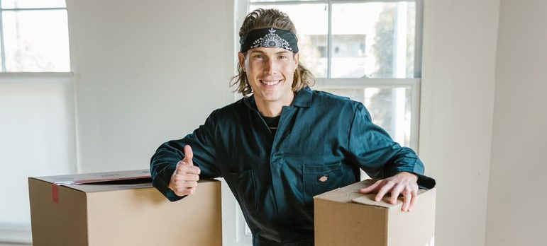mover with two cardboard boxes