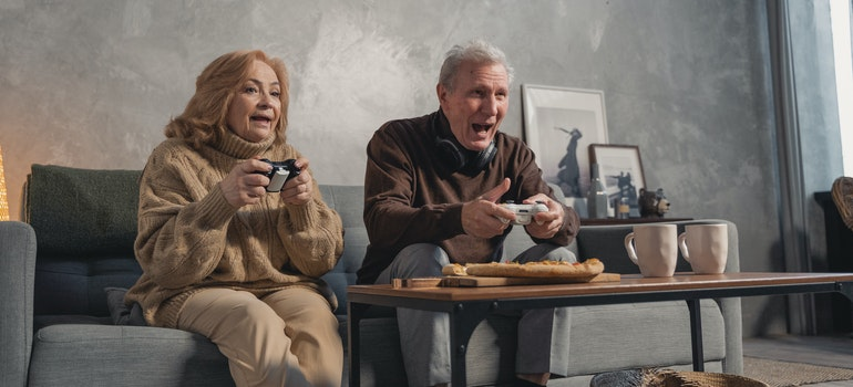 an elder couple playing games