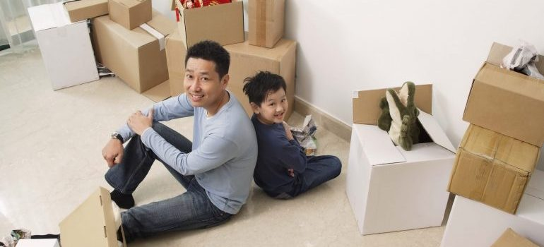 father and son with packing boxes